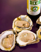Oysters on purple background with a Dixie Beer in a vertical format